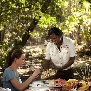 tess atie serving clients on an outback tour